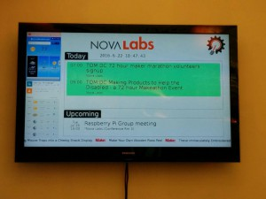 Raspberry Pi-driven meetup info board behind the NoVALabs front desk.